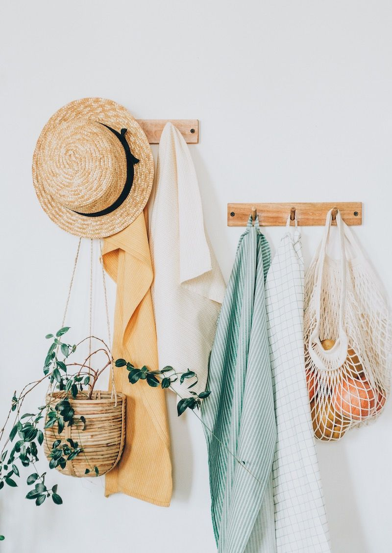 Greenery hanging from coat rack