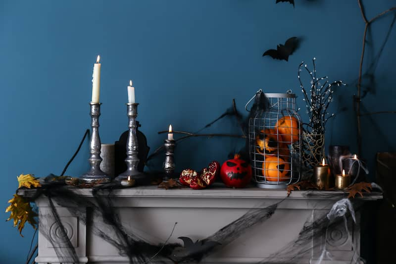 fireplace mantle strewn with Halloween decorations