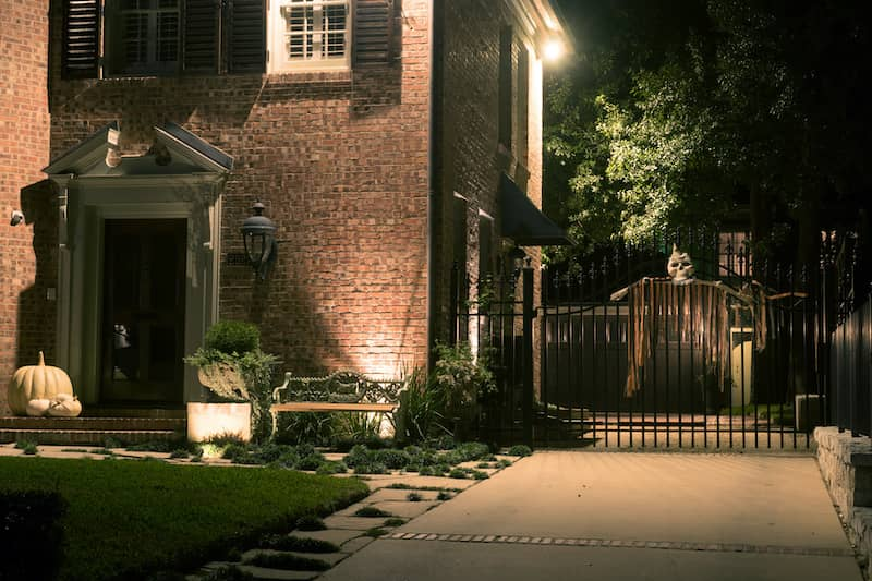 Halloween decorations on porch and driveway