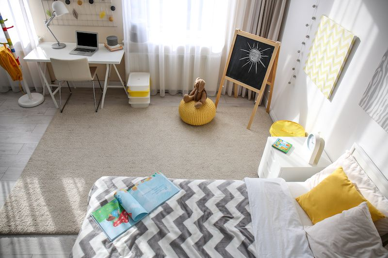 gender neutral yellow and gray kids bedroom