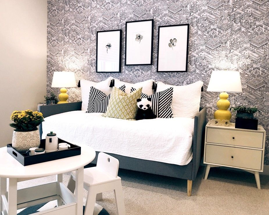 kids day bed with stuffed animals on the bed and lamps on side tables