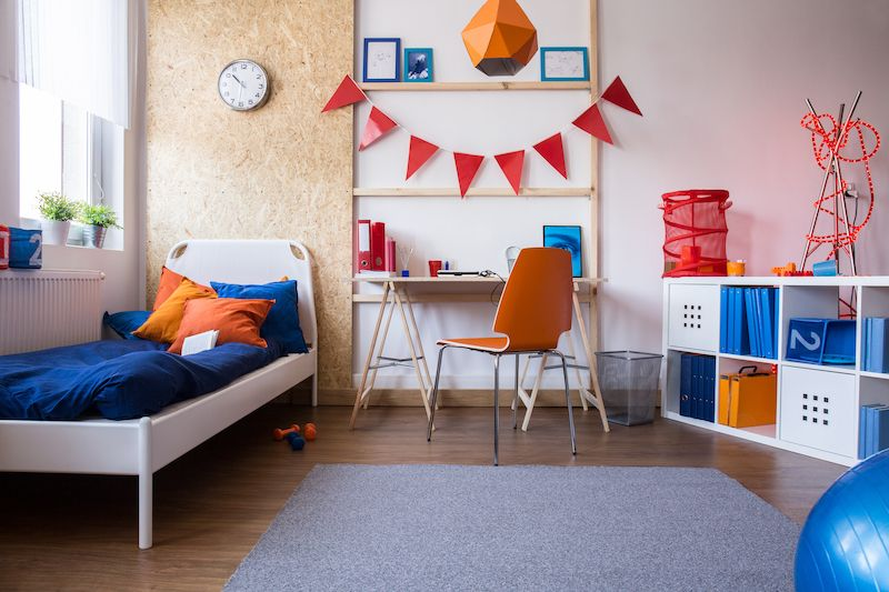 kids room with storage shelving