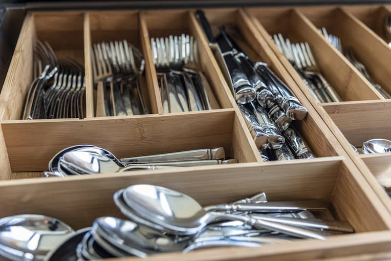drawer of utensils organized with dividers