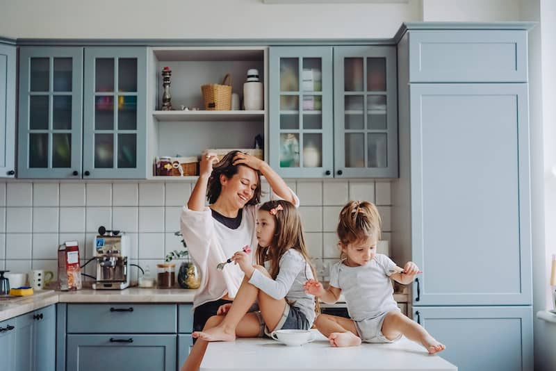 family hanging out in kitchen