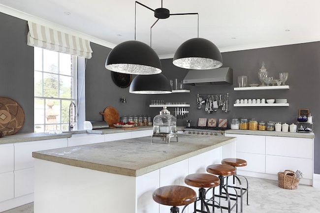 dark gray walls in kitchen with low-hanging lighting