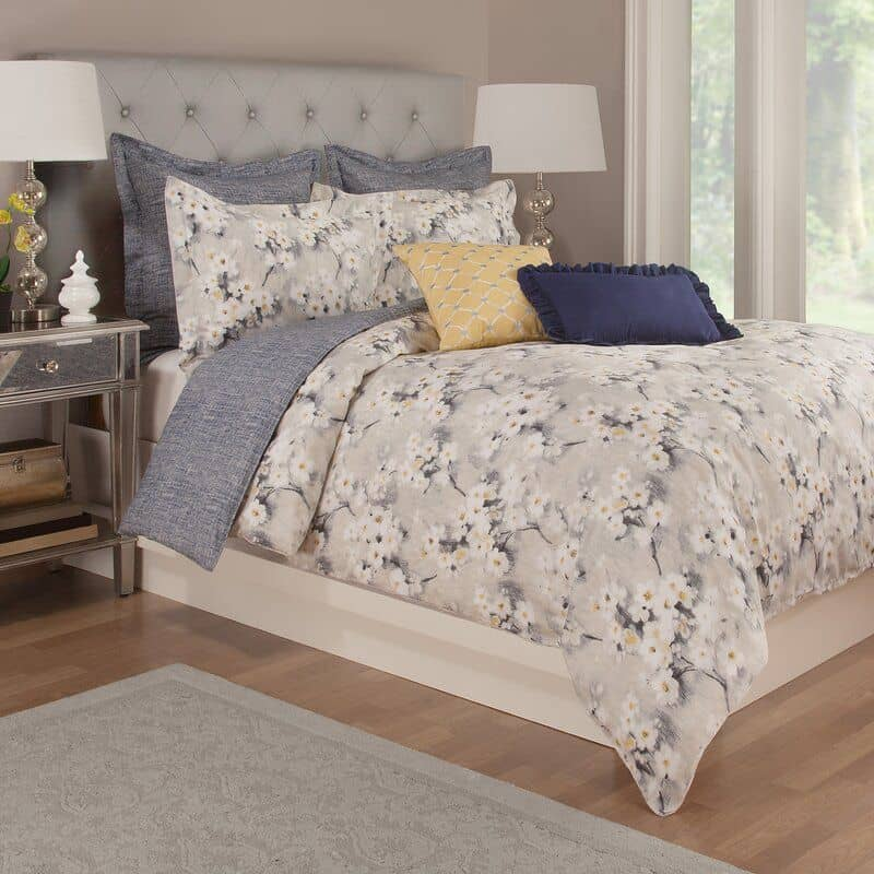 Kreger Cotton Reversible Duvet Cover Set. Floral and grey duvet cover with blue and yellow accent pillows.