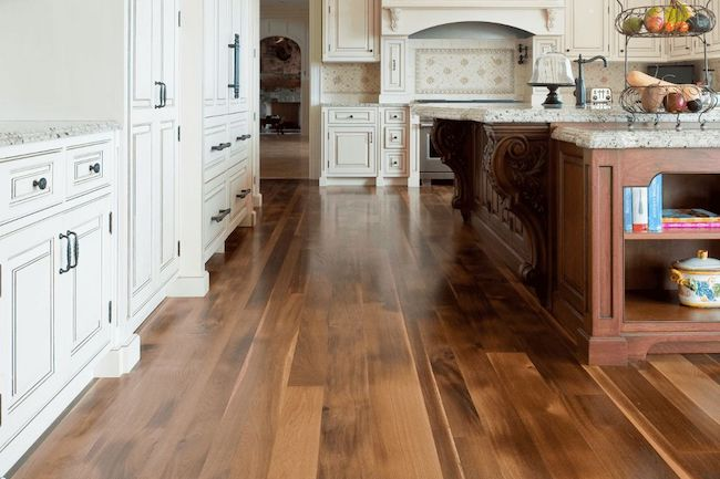 faux wood laminate flooring in kitchen with white cabinets