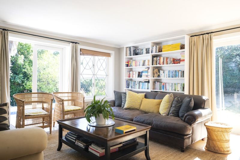 Yellow toned living room with grey couch
