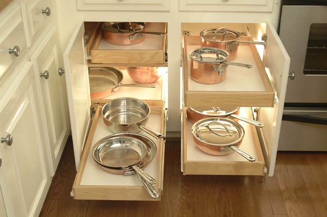 cabinets in a kitchen that roll out