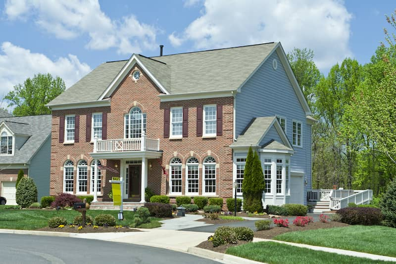 Brick Faced Mansion With white Siding