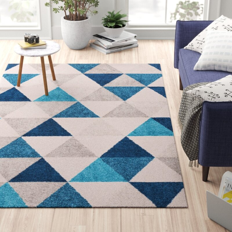 Geometric rug with multiple shades of blue and grey