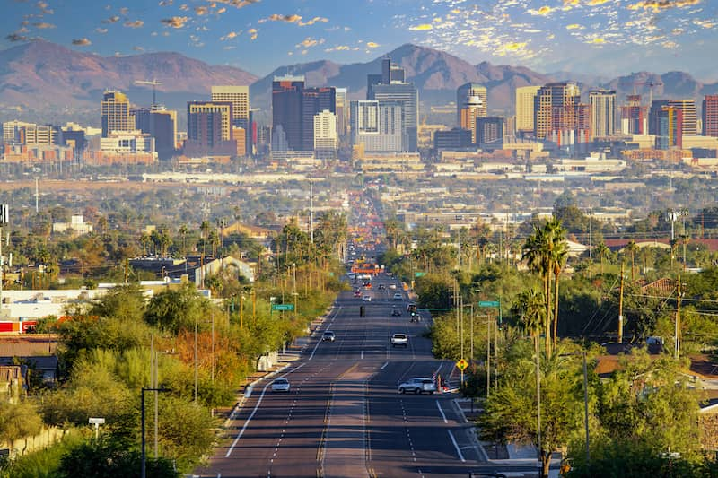 Road leading to Phoenix, Arizona surrounded by mountains, most sustainable cities in the US, most eco-friendly cities, Greenest cities in the US