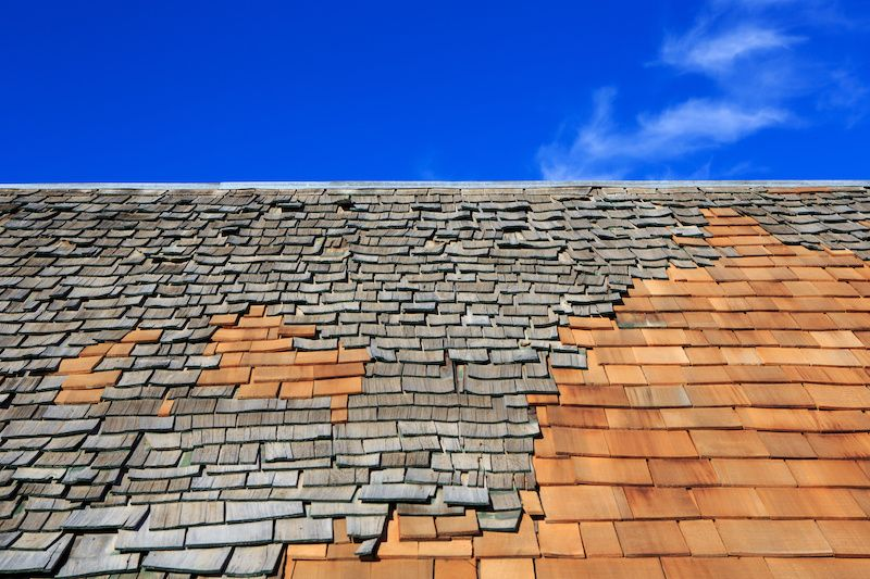 grey and tan mixed wood shingles on a roof