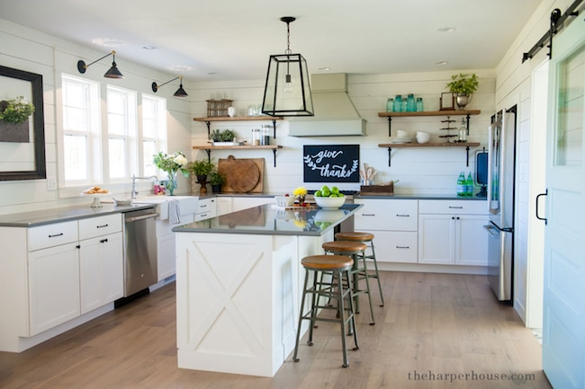 shaker style kitchen with bright white walls and accents