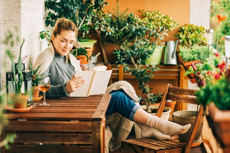 woman reading with feet up