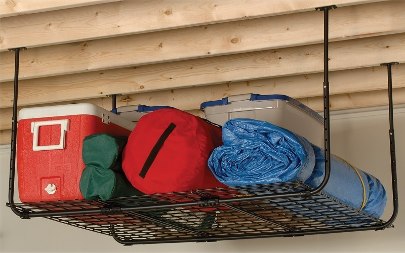 shelf attached to ceiling holding bags