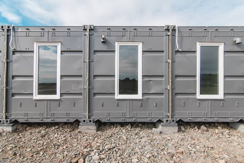 shipping container home side by side with windows