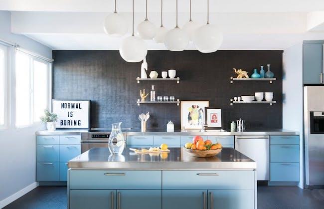 Statement fixtures in dark blue kitchen