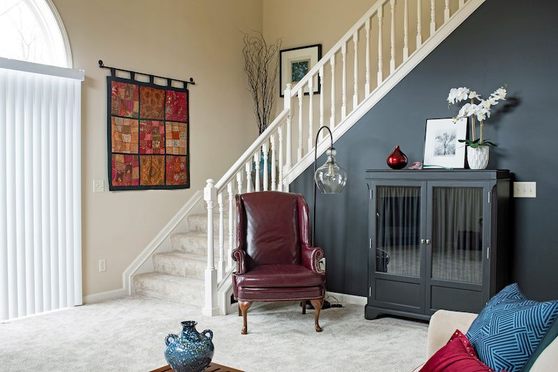 Grey accent wall on a staircase in a living room