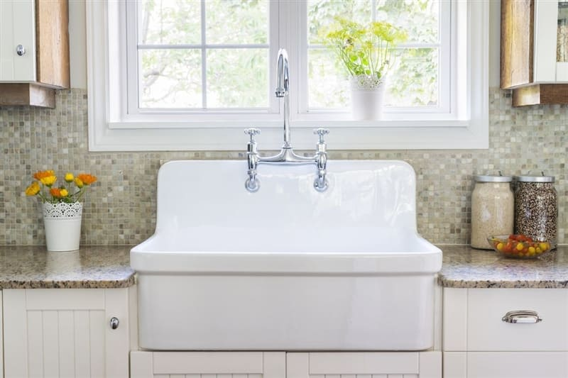 Bright kitchen with large farmhouse sink.