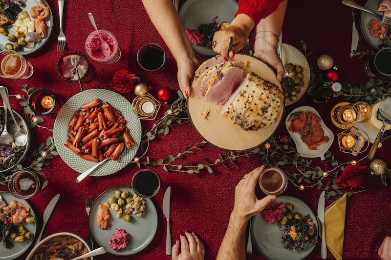 Holiday table spread with holiday food.
