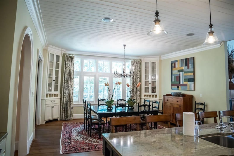 Eat-in kitchen and dining room with shiplap ceiling.
