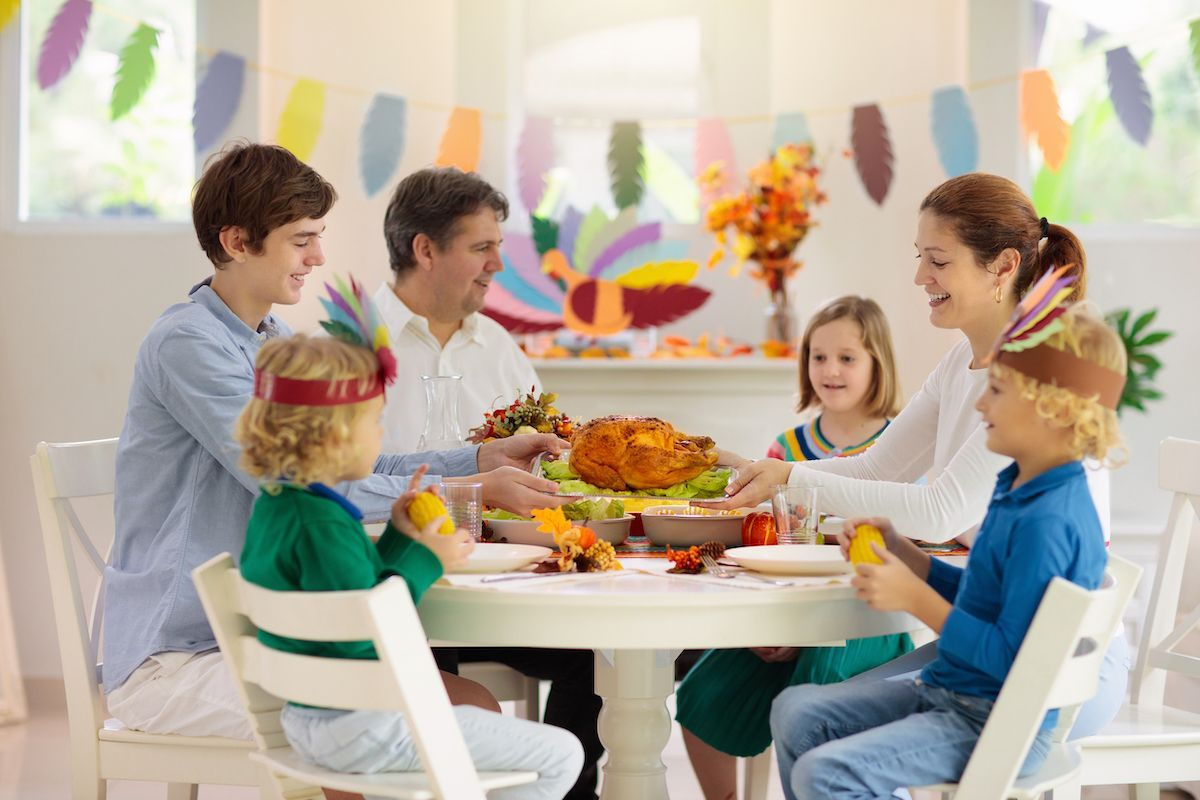 Young family around a festive table.
