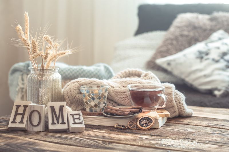 Farmhouse decor and cinnamon sitting on a coffee table in a living room