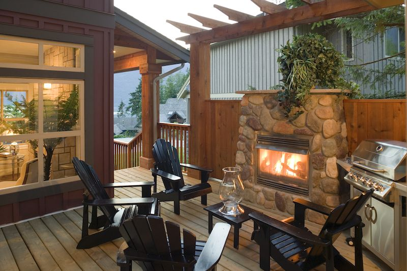 small pergola over fireplace / fire-pit on a porch outdooors