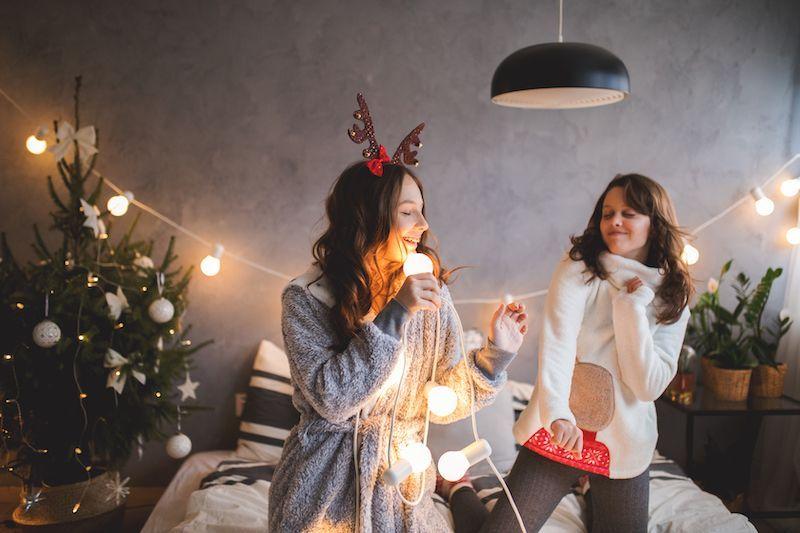 Friends dancing and singing holiday karaoke.