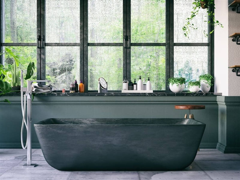 Bathroom with neutral green color palette and plants.