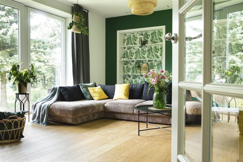 Living room with neutral green and brown hues.