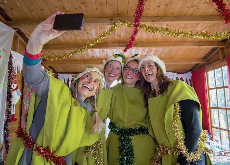 Group of women in a group holiday costume.