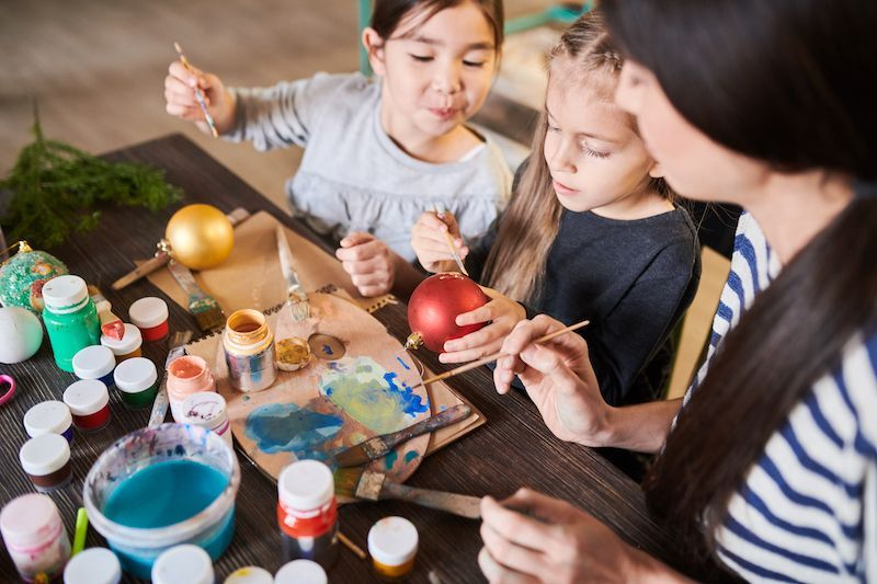 DIY Christmas Ornaments: Children painting holiday ornaments.
