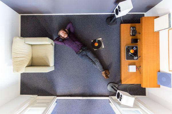 Man listening to music on the floor.