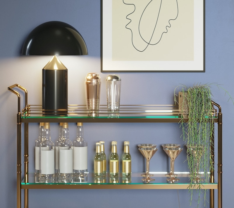 modern blue room with a mini bar trolley with glasses, bottles, a minimal lines art frame and a hanging plant