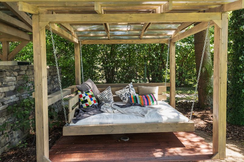 rocking bed attached to small pergola