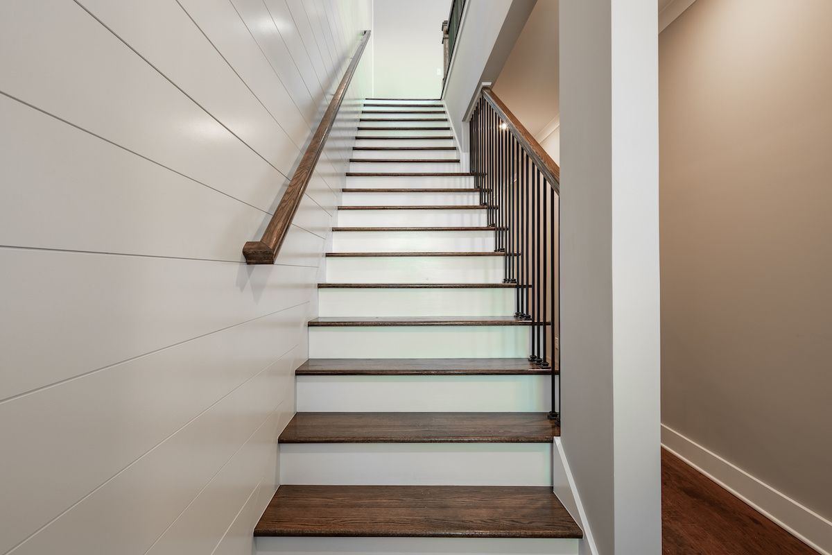 Staircase with shiplap accent wall.