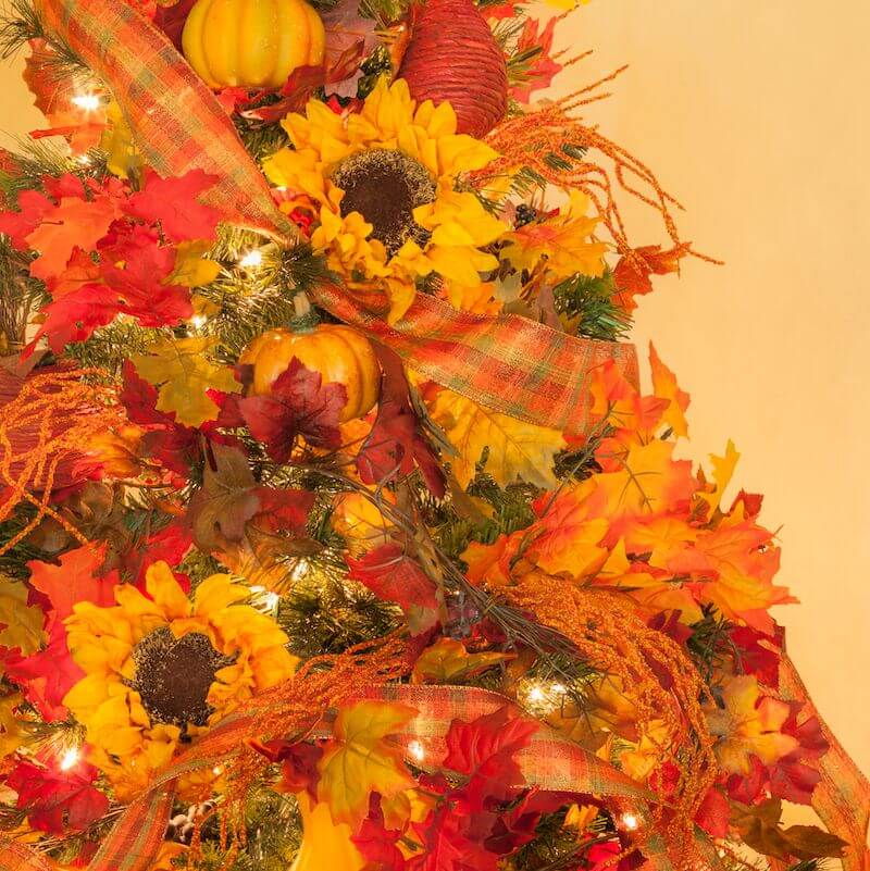 Christmas tree made with sunflowers and autumn gourds.