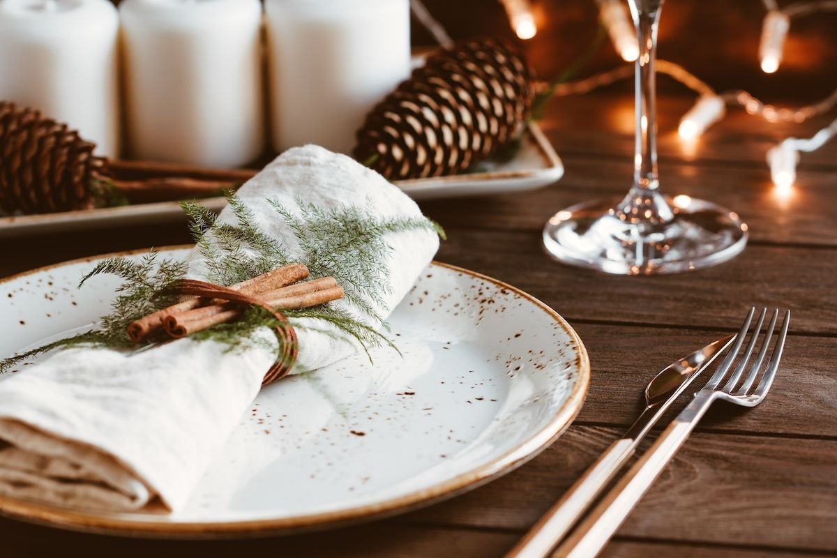 Table setting with pine cones.