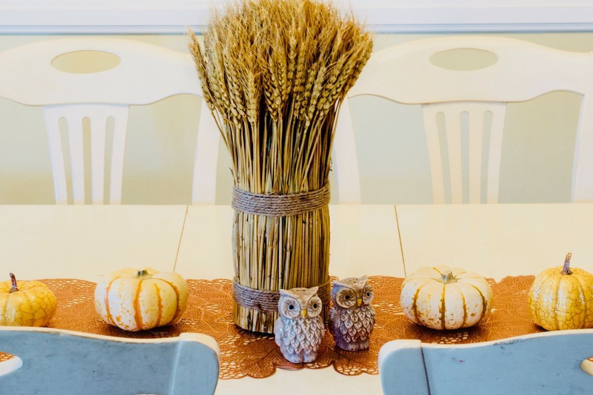 Table with colorful runner and owls.