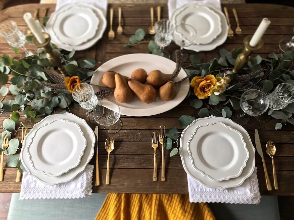 Green, brass and white table decor.