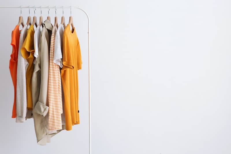 minimalistic clothes on a stand in a light background