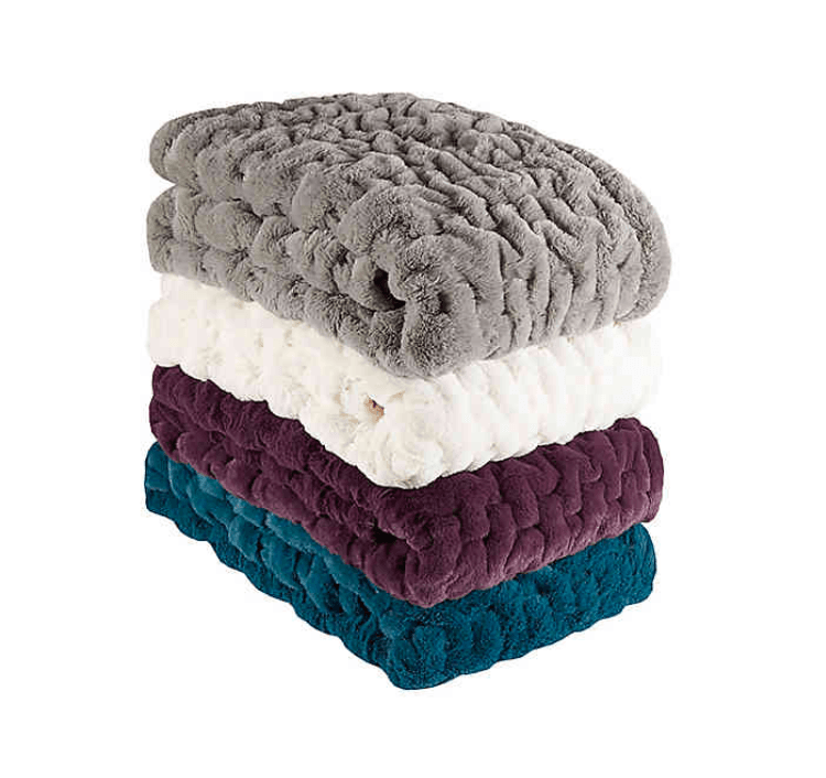 Stack of throw blankets.