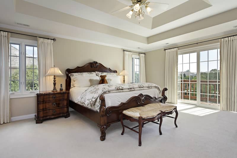 bedroom with double trays in the ceiling