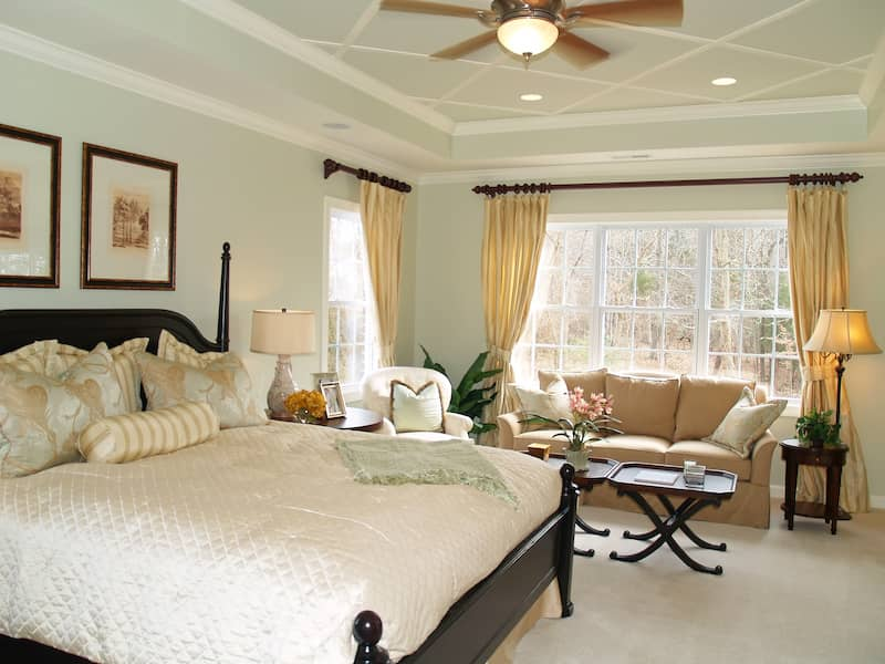 Bedroom with subtle molding and trim on the ceiling