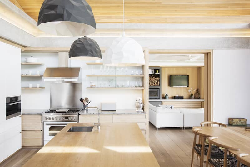 kitchen with tray ceiling with wood paneling inside of it