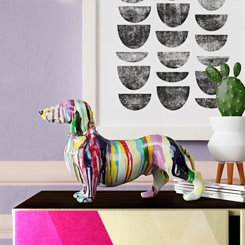 Colorful dachshund sculpture on a table