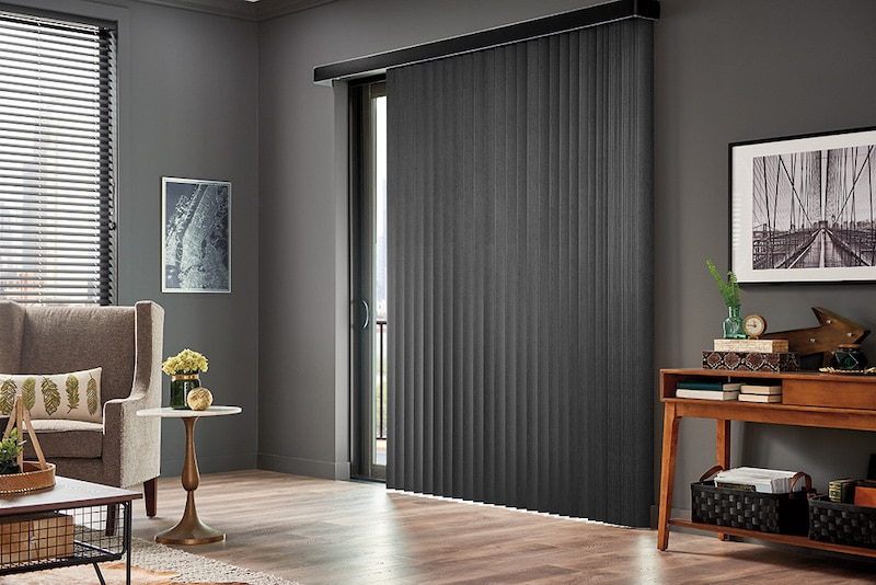 Vertical blinds over a sliding door.