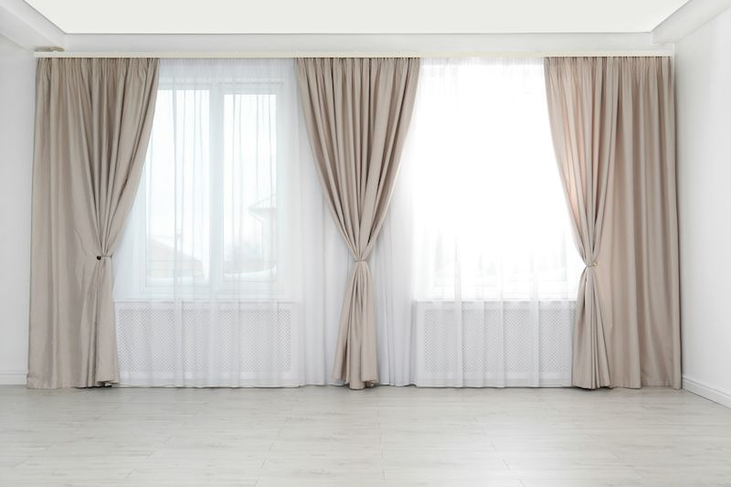 Beige curtains over windows.